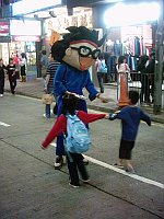 cartoon character passing out fliers
